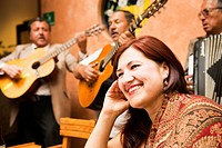 Hispanic woman in restaurant with traditional band