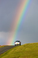 Rainbow over road near Cox Tor in the Dartmoor National Park, Devon, England, UK, Europe.
