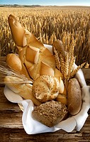 basket of bread in wheat field