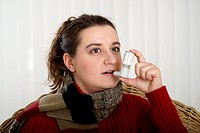 Young woman with asthma, using aspirator, sufferer from asthma, asthma attack, asthma inhaler, ventilatory support, respiratory diseases