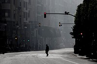 One man alone crossing Colon Street during the Fallas Masclet&#225;, Valencia, Spain