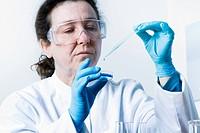 Scientist dropping liquid into petri dish