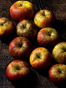 Apples on wooden board