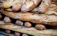 Close up of pile of baguettes for sale