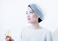 Woman having a glass of champagne