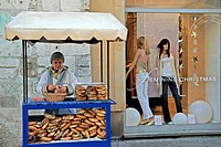 peddler selling bread rolls called Obwarzanek, Krakow, Poland, Central Europe