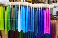 Dipped candles hanging in a shop window, Wales