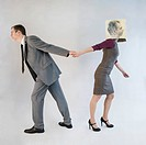 Businessman pulling businesswoman wearing mask
