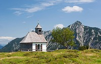 Austria, View of Postalm Chapel, Rinnkogel mountain in background