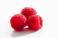 Raspberries on white background, close up