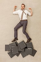 Businessman standing above files