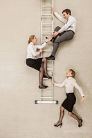 Business people climbing ladder