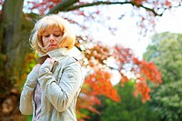 young blonde woman in autumn in park in Germany