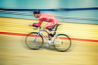 Paralympic gold medal Cyclist Mark Colbourne racing in a velodrome in Newport, South Wales, UK