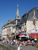 Saint Etienne Quai cafes and church with tourists ,Honfleur, Auge region, normandy, France