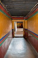 Colourful stripes painted down the walls of a hallway in jokhang temple;Lhasa xizang china