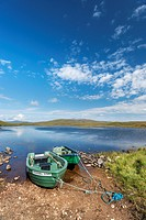 Row boats on the shores of Loch Meadi, Altnaharra, Northern Highlands, Scotland, United Kingdom