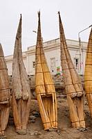 fishing boats made of reed put up at the beach, Peru, Huanchaquito