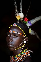 Kenya, Portrait of young Samburu man in traditional dress; South Horr