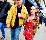 London, England, UK. People in Oxford Street - woman smoking.