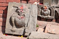 Kathmandu, Nepal. Snow Leopards Carved in Stone inside a Neglected Neighborhood Hindu temple