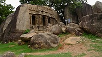 The Main Hill At Mahabalipuram Is Dotted With Pillared Halls Carved Into The Rock Face, Tamil Nadu, India