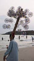 Vendor With Wind Toys On Kovalam Beach, Kovalam, Kerala, India
