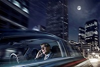 Caucasian businessman driving on cell phone