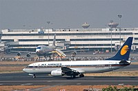 Aeroplane ; An Air-India plane standing at the Chhatrapati Shivaji International Airport terminal while the Jet Airways flight taking off from the run...
