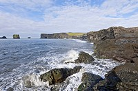 Basalt cliffs and a rock arch on the coast