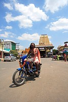 Hindu priest brahmin driving motor cycle ; district Kanchipuram ; state Tamilnadu ; India