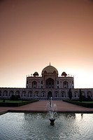 Sunrise at Humayun's tomb built in 1570 made from red sandstone and white marble first garden-tomb on the Indian subcontinent persian influence in mug...