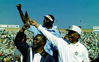 South Africa: Soweto: May 30, 1999: African President Nelson Mandela (right) and Deputy President Thabo Mbeki greet crowds from the top of a golf cart...