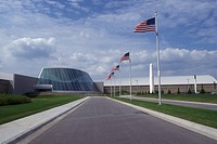 Nebraska, U.S. Flags fly in front of The Strategic Air Command Museum at U.S. Air Force's Strategic Command in Bellevue