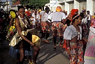 Caribbean, St. Martin, carnival, Caribbean Islands, Local black people wear colorful costumes in a parade during the carnival in Marigot the French ca...