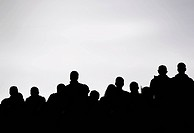 Spectators at a football match, silhouettes