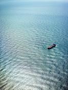 Cargo ships floating in the ocean.