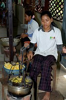 Boiling silkworm cocoons to separate the fibers, Siem Reap, Cambodia