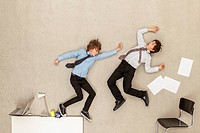 Business boys fighting in office