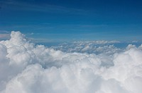 Aerial view of clouds, shot from an airplane over Halmahera, Maluku Islands, Indonesia.