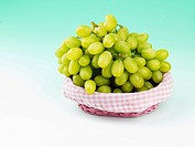 grape in basket on table