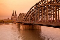 Cologne Cathedral with River Rhine and Hohenzollern Brucke (Bridge), Cologne, Rhine-Westphalia, Germany.