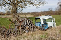 Car wreck and old wooden cart.