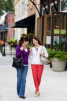 Caucasian women talking on city street