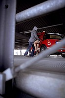 A man is trying to rape a woman in a parking garage. - LEIPZIG, GERMANY, 01/03/2007