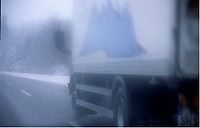 Street traffic in the winter: lorry on a motorway - picture taken threw a dusty screen. - GERMANY, 10/02/2004