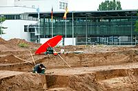 Archaeological excavation of ancient Roman remains in the former government district, at the back the old parliament. - BONN, GERMANY, 16/08/2006
