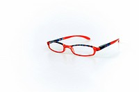 Multicolored eyeglasses on white background. - GERMANY, 07/05/2008