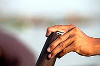 Detail of a fisherman's hand at work on the Mekong River early in the morning outside of Phnom Penh, Cambodia.