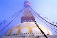 NEPAL, KATHMANDU, BOUDHNATH, TIBETAN STUPA (TEMPLE) IN FOG, PRAYER FLAGS.